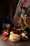 Shrovetide Maslenitsa Butter Week festival meal. Stack of russian pancakes blini. With red caviar, fresh sour cream and cranberry jam on the background of stock images