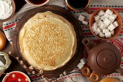 Shrovetide Maslenitsa Butter Week festival meal. Stack of russian pancakes blini stock photo