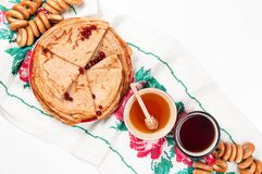 Shrovetide Maslenitsa festival meal. Russian pancake blini with honey and fresh cream cheese on white background. Top view. Flat lay stock image
