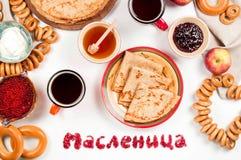 Shrovetide Maslenitsa festival meal. Russian pancake blini with raspberry jam, honey, fresh cream and red caviar on white background stock photography
