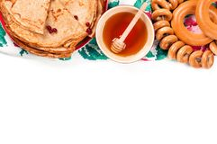 Shrovetide Maslenitsa festival meal. Russian pancake blini with honey and fresh cream cheese on white background. Top view. Flat lay stock photo