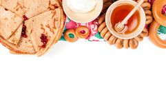 Shrovetide Maslenitsa festival meal. Russian pancake blini with honey and fresh cream cheese on white background. Top view. Flat lay royalty free stock image