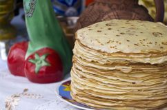 Shrovetide pancakes. On a festive table Stock Photo