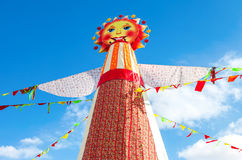 Shrovetide in Russia. Big doll for the burning on the blue sky b Stock Images