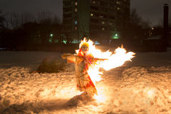 Shrovetide scarecrow burnes at night in snow Royalty Free Stock Image