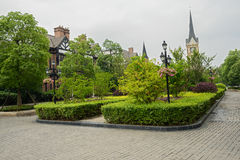 Shrubbery before European-style buildings in spring Stock Images