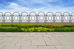 Shrubs and stainless steel fence on blue sky Royalty Free Stock Image