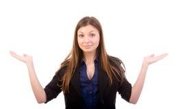 Shrugging женщина в сомнении Стоковое фото RF