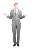 Shrugging. A business man shrugging on white Royalty Free Stock Images
