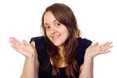 Shrugging amigável da menina Fotografia de Stock
