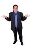 Shrugging do homem de negócios Fotografia de Stock