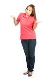 Shrugging I Dont Know Asian Woman At Camera Full. A full length portrait of a cute Asian woman shrugging her shoulders and palms up implying unsure, uncertain Royalty Free Stock Photo