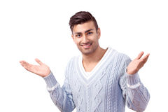 Shrugging man. Young man shrugging with what can I do expression royalty free stock image