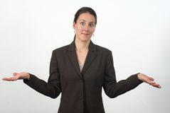 Shrugging woman Stock Photo