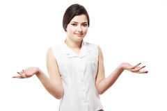 Shrugging woman. In doubt doing shrug showing open palms Stock Image