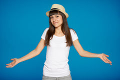 Shrugging woman in doubt. Doing shrug showing open palms Royalty Free Stock Photo