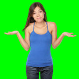 Shrugging woman in doubt. Doing shrug showing open palms. Isolated on green screen chroma key background Royalty Free Stock Image