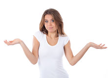 Shrugging young woman in doubt. Portrait of a nice woman having a doubting gesture, isolated on white Royalty Free Stock Photo