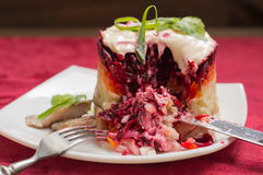 Shuba salad. Cooked beets, carrots, potatoes, onions, herring and mayonnaise. The classic Russian cuisine. Restaurant Stock Photo