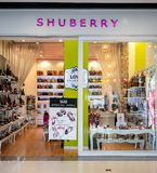Shuberry shop at Central Westgate Bangkok, Thailand, May 10, 201. 8 : Fashionable shoes and bags. Shop interior in vintage style. Front view from entrance stock image