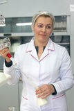 SHUCHIN, BELARUS - JANUARY 26, 2015. Young woman in chemical lab doing microbiological and chemical quality control of milk.  Stock Photos