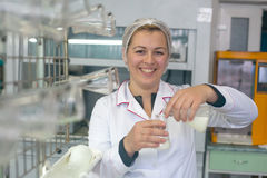 SHUCHIN, BELARUS - JANUARY 26, 2015. Young woman in chemical lab doing microbiological and chemical quality control of milk.  Royalty Free Stock Images