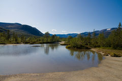 Shuchje lake. A mountain lake with limpid water reflecting the hills behind it Stock Photo