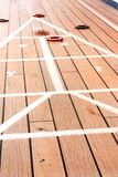 Shuffle board. Being played on the deck of a cruise ship while at sea Royalty Free Stock Photo