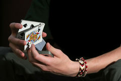 Shuffle shuffle. Teenager boy shuffling cards and preparing for a trick Royalty Free Stock Images