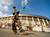 Shuffle (slide) competition. MOSCOW - JULY 25: Luzhniki Olympic Arena, Rollerskater Vitaly Sochnov (Russia) performes Wheel Barrow slide element - Russian Stock Images