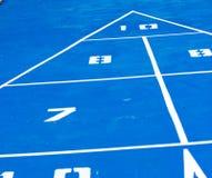 Shuffleboard. Close-up of a bright blue shuffleboard court Royalty Free Stock Image