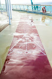 Shuffleboard Court on Wet Deck Stock Images