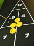 Shuffleboard court. Court  for shuffleboard with yellow discs, background Stock Photos