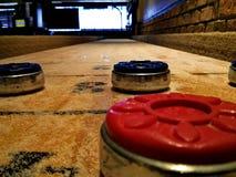 Shuffleboard game. Shuffleboard  game in the bar Royalty Free Stock Image