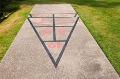 Shuffleboard scoring. Scoring diamond on concrete shuffleboard court in a grassy area at a resort Stock Photos