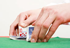 Shuffling cards Stock Images