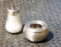 Shugar shaker and ashtray Stock Photo