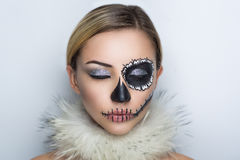Shugar skull mask. Day of the Dead, Skull Mask. Art woman beautiful face painted as a traditional day of dead, white fur. Free place on photo for congratulations royalty free stock image