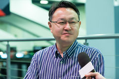 Shuhei Yoshida. Sony worldwide studios president close up. Shuhei Yoshida, Sony world wide studios president, giving interviews about Morpheus and PlayStation 4 stock photos