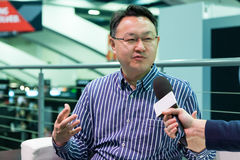 Shuhei Yoshida. Sony worldwide studios president. Shuhei Yoshida, Sony world wide studios president, giving interviews about Morpheus and PlayStation 4 at GDC Royalty Free Stock Image