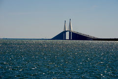 Shunhine Skyway Bridge. The sunshine skyway bridge extends over the Tampa bay that empties into The Gulf of Mexico. The bridge is lit up from the mid day sun stock images