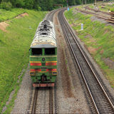 Shunting diesel locomotive. By rail goes a shunting diesel locomotive Royalty Free Stock Images