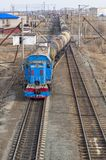 Shunting locomotive transports cars. Tyumen Stock Photos