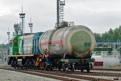 Shunting locomotive transports tank on other way. Tobolsk, Russia - July 15. 2016: Sibur company. Denisovka railway station. Shunting locomotive transports the Stock Photos