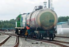 Shunting locomotive transports tank on other way. Tobolsk, Russia - July 15. 2016: Sibur company. Denisovka railway station. Shunting locomotive transports the royalty free stock image