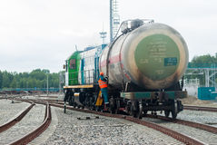 Shunting locomotive transports tank on other way. Tobolsk, Russia - July 15. 2016: Sibur company. Denisovka railway station. Shunting locomotive transports the Stock Image