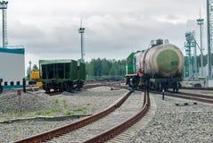 Shunting locomotive transports tank on other way. Tobolsk, Russia - July 15. 2016: Sibur company. Denisovka railway station. Shunting locomotive transports the stock photography