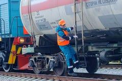 Shunting locomotive transports tank on other way. Tobolsk, Russia - July 15. 2016: Sibur company. Denisovka railway station. Shunting locomotive transports the stock photos
