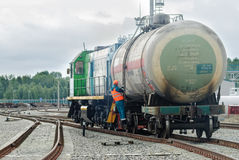 Shunting locomotive transports tank on other way. Tobolsk, Russia - July 15. 2016: Sibur company. Denisovka railway station. Shunting locomotive transports the Stock Photography