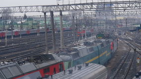 The shunting train approaches the station. The trains are waiting stock video